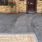 slate grey drive with a deep red door