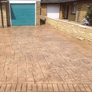 sandy coloured cobbled drive and blue garage door