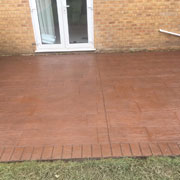 orange paving stones and a conservatory door